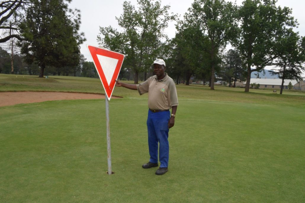 Golf Club And Street Signs Targeted