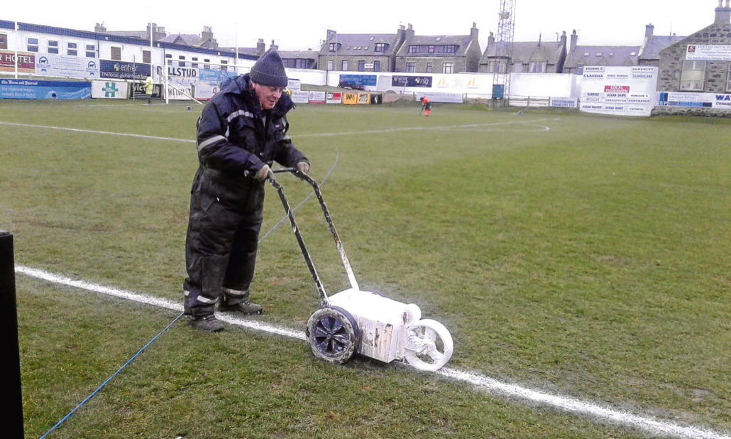 Volunteers Assist Match Preparation