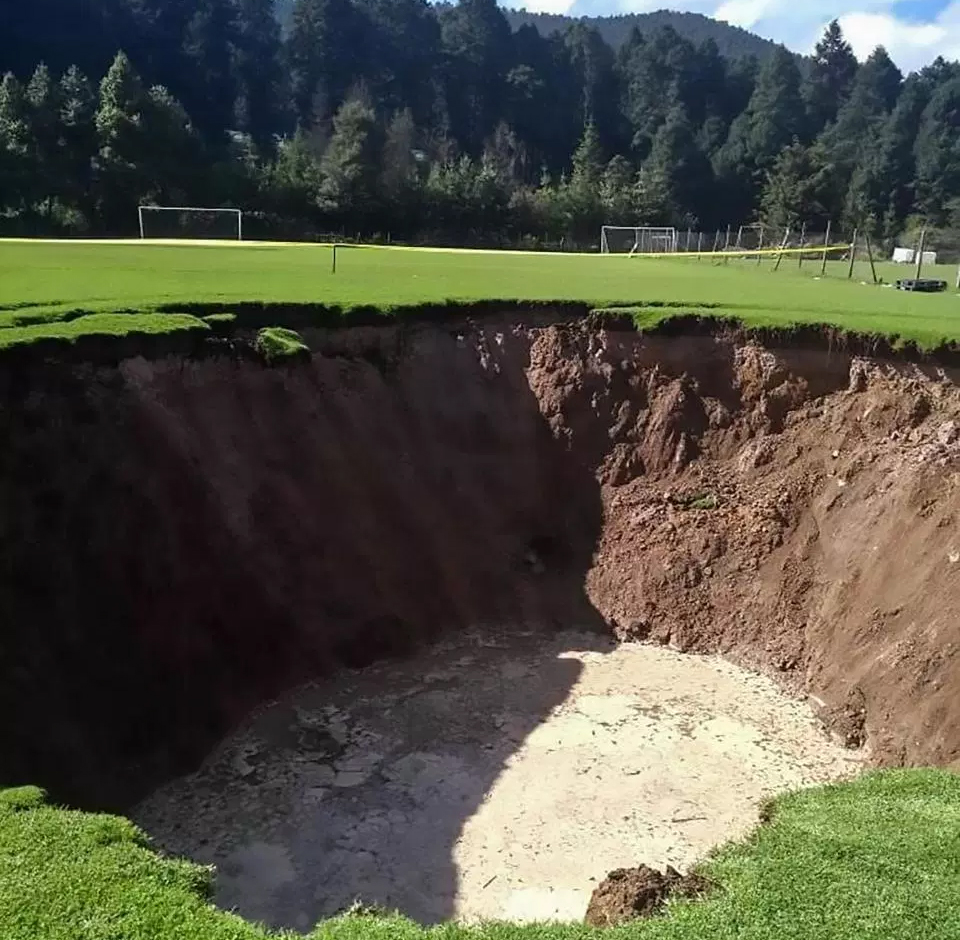 Giant Sinkhole Appears On Pitch