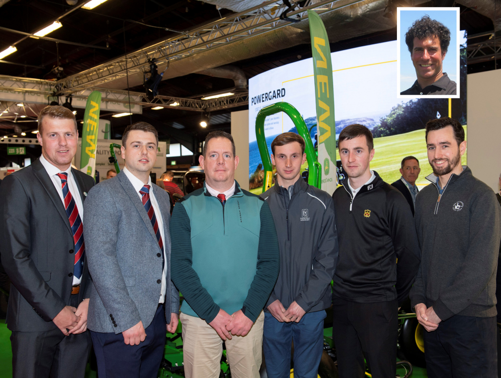 7 BIGGA and GCSAI volunteers stand together in front of the John Deere Stand at BTME 2020