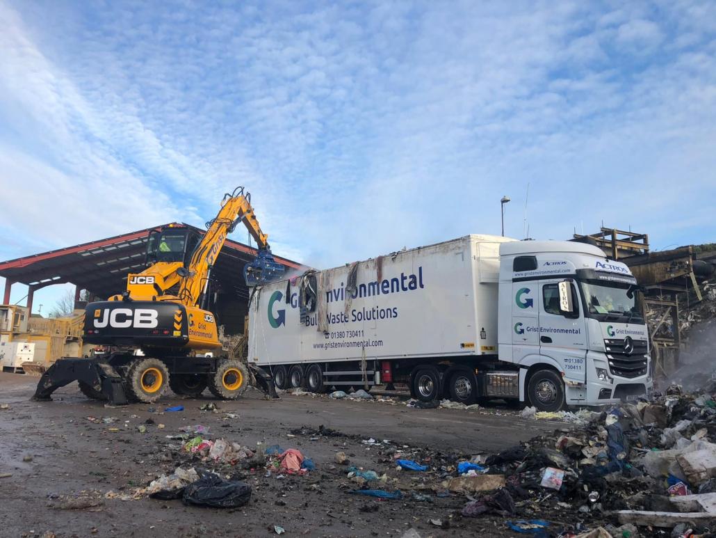 JCB Wheeled Excavator at Grist Environmental waste transfer site in Devizes, Wiltshire.