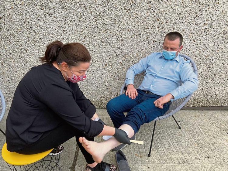 Greenkeeper gets legs waxed for charity